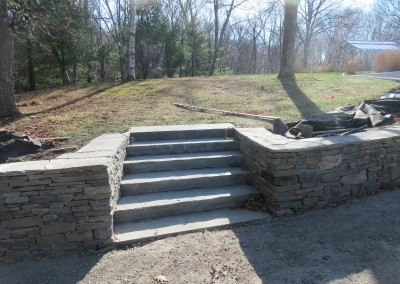 Stone retaining wall and large stone steps