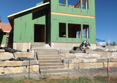 New home being built in Greene County, NY with stone steps and retaining wall